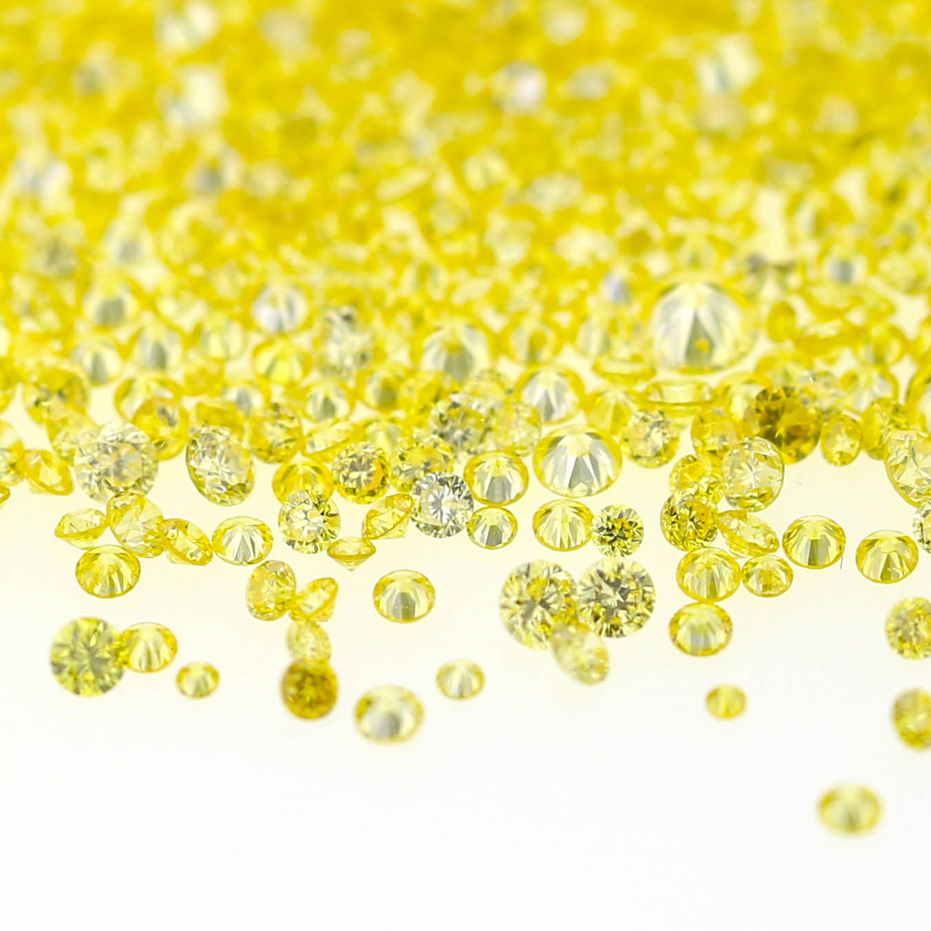 Natural Fancy Intense Yellow 0.01 ct to 0.08 ct Round cut Diamonds Parcel Melles